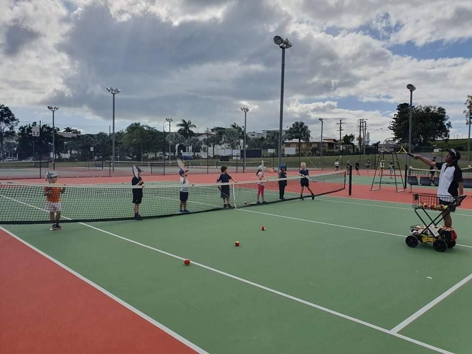 This is an image of junior tennis coaching at Gladstone Tennis Centre